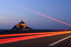 Driving to Mont Saint Michel. Evening falls at Mont Saint Michel, Normandy, France stock photos