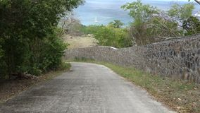 Driving from the top of bequia in the caribbean stock footage