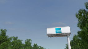 Driving towards advertising billboard with American Express logo. Editorial 3D rendering Royalty Free Stock Photos