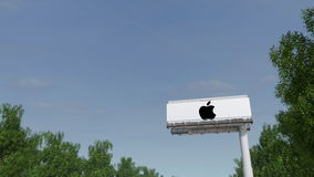 Driving towards advertising billboard with Apple Inc. logo. Editorial 3D rendering. Driving towards advertising billboard with Apple Inc. logo. Editorial 3D Royalty Free Stock Photo
