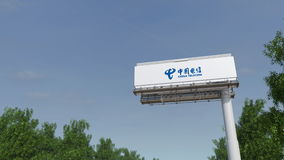 Driving towards advertising billboard with China Telecom logo. Editorial 3D rendering 4K clip stock footage