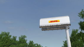 Driving towards advertising billboard with DHL Express logo. Editorial 3D rendering 4K clip