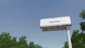 Driving towards advertising billboard with Morgan Stanley Inc. logo. Editorial 3D rendering 4K clip. Driving towards advertising billboard with Morgan Stanley stock footage