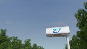 Driving towards advertising billboard with SAP SE logo. Editorial 3D rendering Royalty Free Stock Images