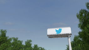 Driving towards advertising billboard with Twitter, Inc. logo. Editorial 3D rendering. Driving towards advertising billboard with Twitter, Inc. logo. Editorial Stock Photography