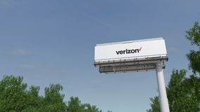 Driving towards advertising billboard with Verizon Communications logo. Editorial 3D rendering 4K clip
