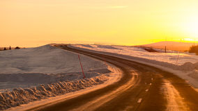 Driving towards Sun on winter road Stock Images
