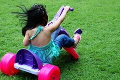 Driving the tricycle Stock Photography