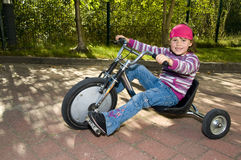 Driving trike Royalty Free Stock Image