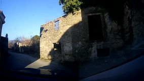 Driving trough small village stock footage