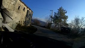 Driving trough small village stock video footage