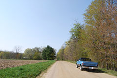 Driving Truck. A truck on a dirt road in rural Michigan on a nice sunny day Royalty Free Stock Photos