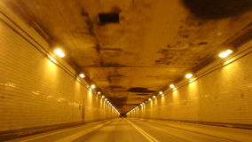 Driving Through A Tunnel. Driving in a car through a tunnel stock video footage