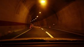 Driving in a tunnel. Driving a car through a tunnel stock footage