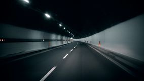 Driving in tunnel. Fast turn. Driving in tunnel road 4K stock footage