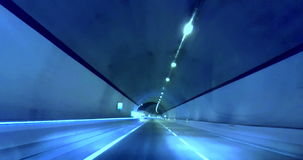 Driving through tunnel gallery and blue tint, abstract with motion blur high speed with warp stock footage