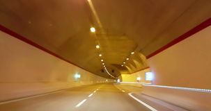 Driving through tunnel gallery and orange light tint, abstract with motion blur high speed with warp. Effect stock video