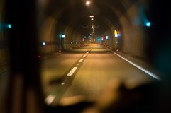 Driving through tunnel. Driving through a long tunnel with a vehicle Royalty Free Stock Images