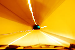 Driving through tunnel at night. Blurry Stock Photography