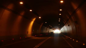 Driving through tunnel, POV stock video footage