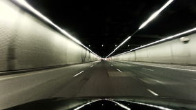 Driving in tunnel. Timalapse using suction cup video camera stock footage