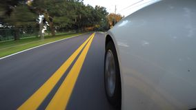 Driving on a two lanes road stock video