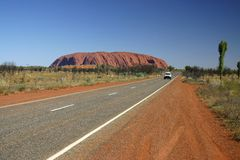 Driving beside Uluru. A world heritage landscape in outback Australia. Ayers Rock. Northern Territory, Australia Royalty Free Stock Image