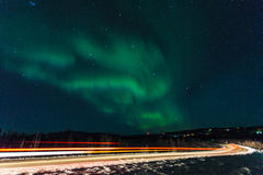 Driving under the Aurora royalty free stock image