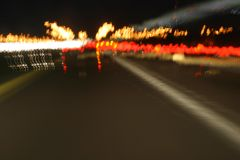 Driving Under the Influence. A long exposure image of the freeway at night, intended to simulate driving under the influence, or possibly exhaustion or vision Stock Photo