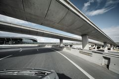 Driving under overpass Royalty Free Stock Photos