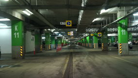 Driving through underground parking stock video footage