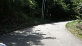 Driving up a narrow road on bequia in the windward islands stock footage