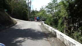 Driving up a narrow road on bequia in the windward islands stock video footage