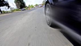 Driving on urban road stock video footage