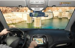 Driving while using navigation system towards Hoover Dam, Arizona, USA. Driving a car while using the screen of a GPS navigation system towards Hoover Dam and royalty free stock photo