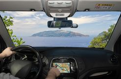 Driving while using navigation system towards Sorrento Peninsula. Driving a car while using the touch screen of a GPS navigation system towards Sorrento stock images