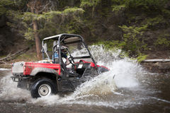 Driving UTV Through Water Crossing Royalty Free Stock Images