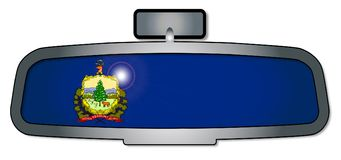 Driving Through Vermont. A vehicle rear view mirror with the flag of the state of Vermont Stock Photography