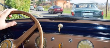 Driving vintage cars Royalty Free Stock Images