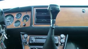 Driving in a Vintage Stag Car. Taking a drive in a vintage Stag sports car, looking at the wooden dashboard and changing gears. Manual gear stick and convertible stock video