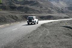 Driving through black volcanic landscape, Spain Stock Photography