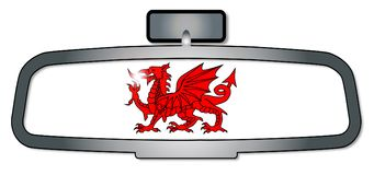 Driving Through Wales. A vehicle rear view mirror with the red dragon of Wales Royalty Free Stock Images