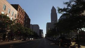Driving on West Saint Clair Avenue in Cleveland. CLEVELAND - Circa September, 2016 - A driving perspective on West Saint Clair Avenue in downtown Cleveland, Ohio stock video