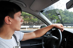 Driving on the wet road Royalty Free Stock Photos