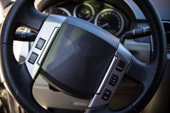 Driving Wheel. Image showing a close up of a driving wheel with commands on it Stock Photography