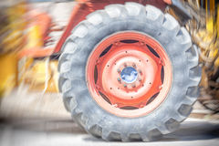 Driving wheel in old tractor Stock Photography