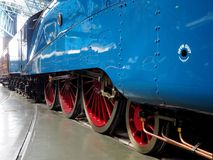 Driving wheels and coupling side rods of the London and North Eastern Railway steam locomotive Mallard 4468. Driving wheels and coupling side rods of the London Royalty Free Stock Photography