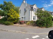 Driving by house with model aircraft in garden on the road to Whithorn stock photo