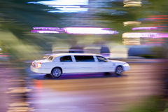 Driving white stretch limousine Stock Photos