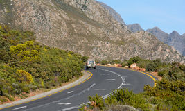 Driving a winding road. A 4x4 driving on a winding road through the mountains Stock Image